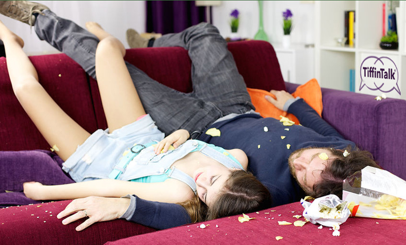 sofa couple passed out exhausted chaos mess 30033363 s 800x483